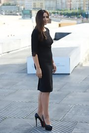 Monica Belluci styled her slimming LBD with sky-high black Christian Louboutin platform pumps.