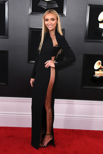 Giuliana Rancic went racy in a black sheer-panel column dress by Tom Ford at the 2019 Grammys.