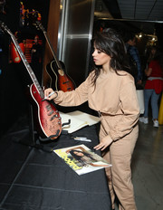 Camila Cabello looked comfy in a cropped sweater at the Grammy charities signings.