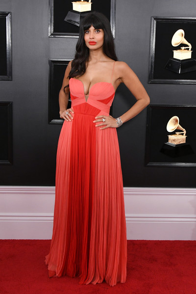 Jameela Jamil turned heads in a cleavage-baring coral and red gown by J. Mendel at the 2019 Grammys.