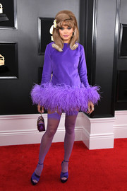 Andra Day couldn't be missed in this bright purple feathered cocktail dress by Cheng-Huai Chuang at the 2019 Grammys.