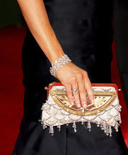 Alyson paired her elegant evening gown with a beaded clutch.