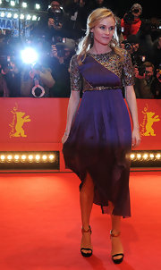 Diane Kruger complemented her purple gown with black and gold Gucci stilettos.