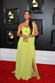 Lilly Singh matched her dress with a pair of chartreuse satin platforms.
