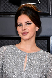 Lana Del Rey looked retro-glam with her loose, center-parted bun at the 2020 Grammys.