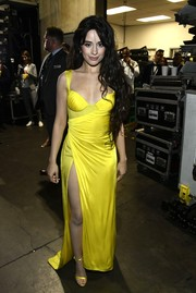 Camila Cabello finished off her dress with coordinating satin sandals, also by Versace.