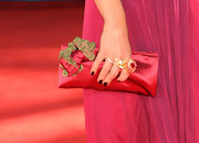Kristen perfectly paired her red dress with a stunning two finger flower ring.