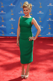 Lauren Bosworth opted for a secretary chic look wearing a classic green dress with white peep toes.