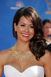 Brooke Burke showed off her long side swept curls while hitting the Emmy Awards red carpet.