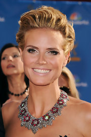 Heidi Klum vamped up her look with dramatic lashes and iridescent white shadow. It was the perfect way to allow her sparkling necklace to shine.
