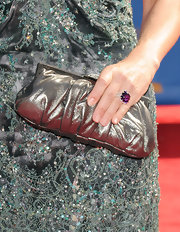 Jennifer Westfeldt carried a metallic silver frame clutch to complete her elegant ensemble at the Primetime Emmy Awards.