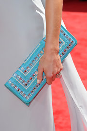 Lara Spencer paired her soft grey dress with a turqouise gemstone inlaid envelope clutch.