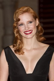 Jessica Chastain finished off her look with bold red lipstick.