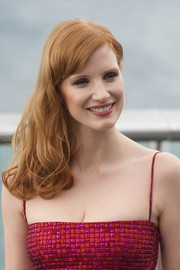 Jessica Chastain wore her hair loose and wavy with side-swept bangs during the 'Eleanor Rigby' photocall.