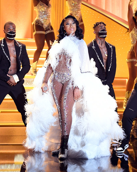 Megan Thee Stallion channeled her inner Vegas showgirl in a feathered cape by Dolce & Gabbana for the 2021 Grammys.