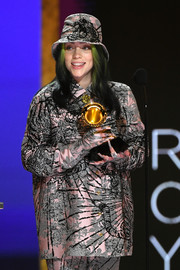 Billie Eilish chose an oversized jacquard shirt and a matching bucket hat and pants for her 2021 Grammys look.