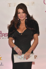 Lisa Vanderpump arrived for the Miss Universe Pageant carrying an ivory envelope clutch with a crystal-studded flap.