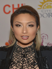 Jeannie Mai wore her hair teased at the top and brushed back at the sides for a casual yet stylish look during the Miss Universe Pageant.