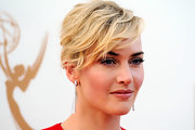 Kate Winslet wore a variation on a classic bun to the 63rd Emmys. To create her romantic look, make subtle curls, section out heavy bangs and pull the rest back into a ponytail. Twist and wrap the tail and secure with bobby pins.