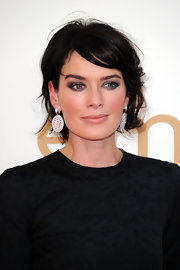 Lena Headey complemented her black dress with a pair of sterling dangle earrings at the Emmy Awards.