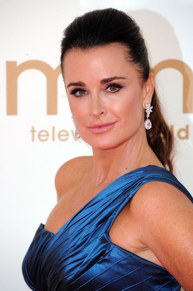 Kyle Richards wore a glammed-up ponytail to the 63rd Emmys. To try her look, backcomb hair through the crown, then comb slightly to smooth. Next, pull hair back and create a high ponytail. To finish, mist with a strong-hold hairspray.
