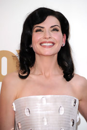 Julianna Margulies brought some old Hollywood glamour to the 63rd Emmys. Her shiny tresses were set in waves, smoothed and misted with a workable hold hairspray.