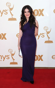 Aleksa Palladino looked elegant at the 2011 Emmys in a purple jersey asymmetrical one shoulder draped gown. She paired the look with tousled tresses.