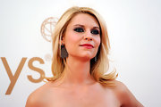 To recreate Claire Danes' sultry eye makeup look, begin by lining top and bottom lash lines and the inner rims with a soft, black eye pencil. Next, sweep a sparkly, gunmetal gray shadow across upper lids and blend into creases to create dimension. To finish the look, add a pale, silvery shadow under the brow bones and coat lashes with several coats of a volumizing mascara.