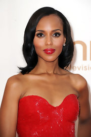 Kerry Washington's bright eyes were the feature focus at the 63rd Emmys. To try her look, first line top and bottom lash lines with a dark eye pencil. Use lash glue to attach false lash strips to upper lash lines and finish with a generous coat of mascara. To add some additional drama, use a white eye pencil to line the inner rims.