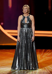 Jane shined on stage at the Emmys in a metallic gunmetal gray gown. The draped halter frock perfectly showed off her statuesque figure.