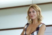 Sienna Miller attended the 'High-Rise' photocall wearing her signature messy-cute waves.