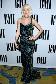 Taylor Swift cut a sleek figure in her draped velvet Monique Lhuillier gown at the BMI Pop Awards.