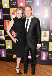 Kirsten Dunst paired her high-necked black LBD with matching pointy satin ankle strap pumps adorned with feminine flowers.
