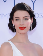 Jessica Pare epitomized retro glamour with her dark locks styled in a thickly curled updo.