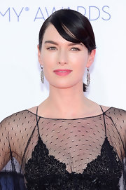 Lena Headey wore her hair in a neat ponytail and side-swept bangs at the Emmy Awards.