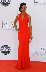 Shaun Robinson wore a bright summer color to the Emmy Awards.