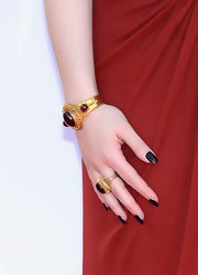 Kat Dennings polished off her romantic Emmys look with a rich oxblood manicure.