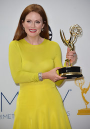 Julianne Moore styled her standout yellow gown with an eye-catching Fred Leighton art deco diamond bracelet.