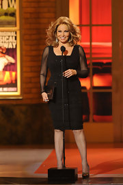 Raquel Welch opted for a classic knee-length LBD with sheer sleeves and sequin detailing.