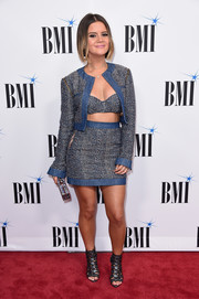 Maren Morris hit the BMI Country Awards wearing a blue tweed jacket, mini skirt, and bra ensemble.