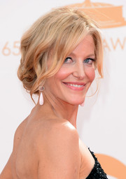 Anna Gunn pulled back her blonde waves into a low messy updo for a soft and ethereal look on the red carpet.