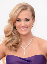 Carrie's chose a soft pink lip to contrast her dark hued gown.