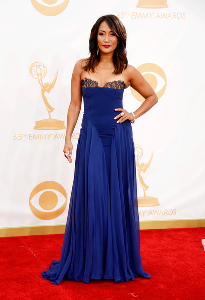 Carrie Ann sported a flowing blue gown with a fitted bodice and black lace detailing on the bust line.