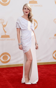 Lily Rabe's draped dress featured a leg-bearing short skirt as well as a flowing skirt panel.