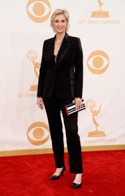 Jane stayed true to her aesthetic, opting for a black pantsuit with satin trim.