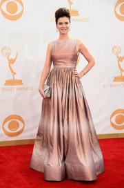 Betsy donned an iridescent praline-colored gown, with subtle stripes.