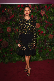Gugu Mbatha-Raw went for simple styling with a pair of black ankle-strap sandals.