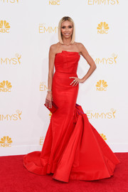 The 'Fashion Police' star matched the red carpet in a structured strapless rouge gown at the 2014 Emmy Awards.