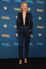 For the Directors Guild of America Awards, January Jones suited up in sexy style in this navy Sandro number teamed with a deep-V bodysuit.