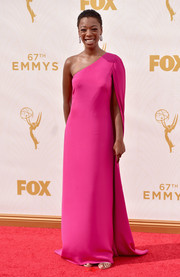 Samira Wiley looked simply divine in a caped fuchsia one-shoulder gown during the Emmy Awards.
